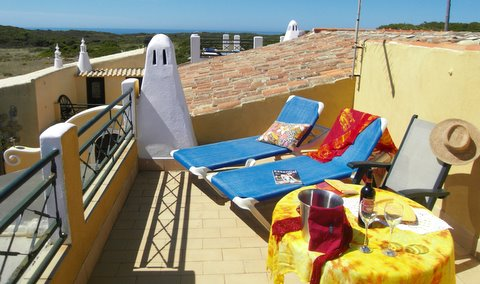 Wide views over fields towards Zavial and Ingrina Beach roof terrace 1001 Nights Bungalow